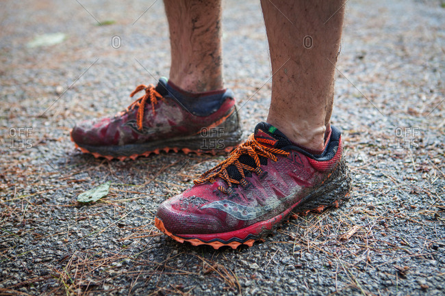 Red River Gorge, Kentucky, USA - June 1, 2018: Muddy running shoes of participant in the War Hammer 100 Mile Endurance Run at the Natural Bridge aid station