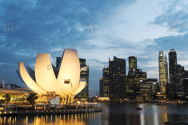 Singapore - July 16, 2012: Exterior of ArtScience Museum and city lights of Singapore's skyline at dusk