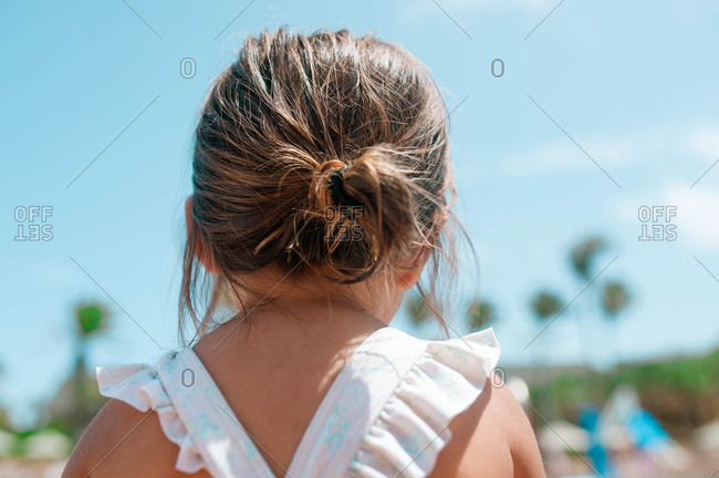Rearview of little girl's head showing hair tied in bun