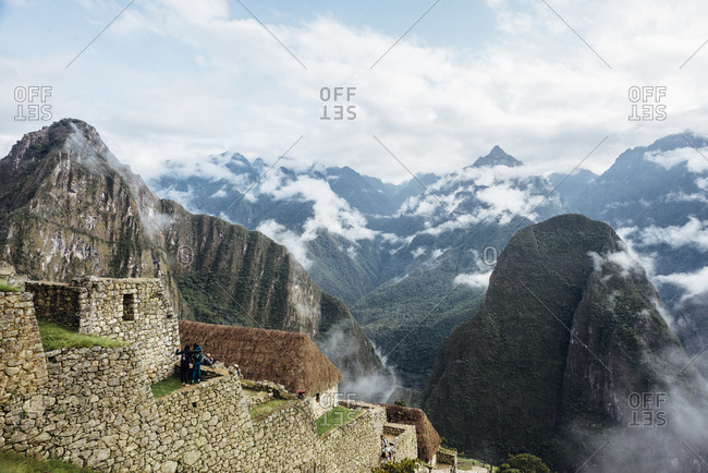 Scenic view of rock wall and housing in Machu Picchu mountainside