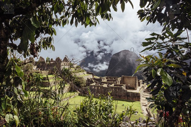 View through trees of Incan ruins in Peru