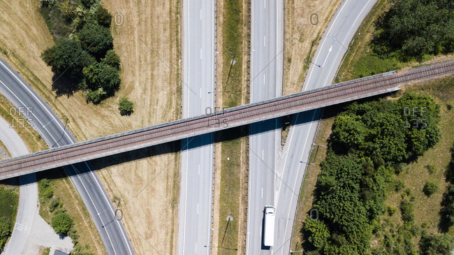 Semi truck driving on rural freeway from above