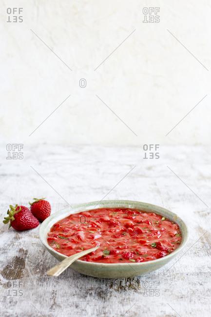 Bowl of homemade strawberry basil jam