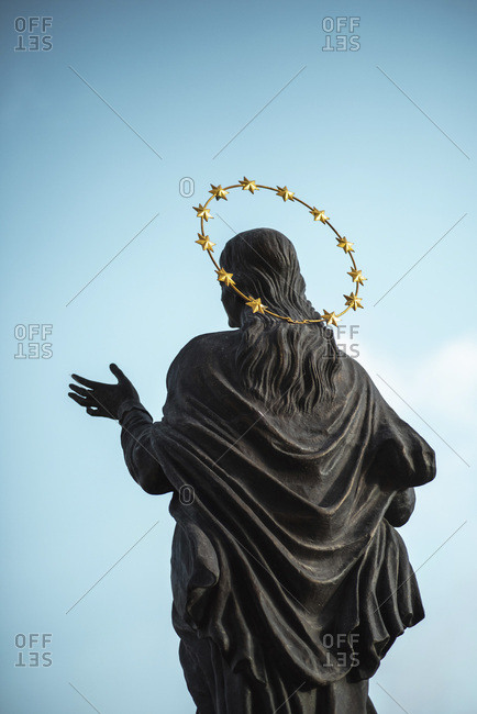 Statue of robed female with starred halo