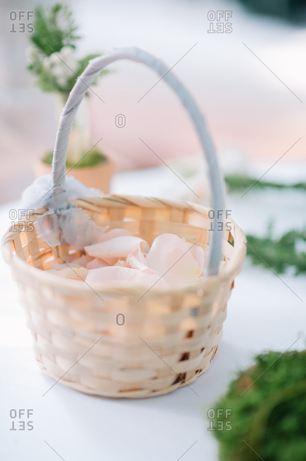 Rose petals in a flower girl basket