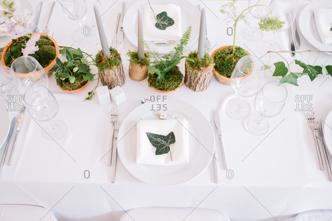 Rustic natural centerpieces on set table at a wedding reception