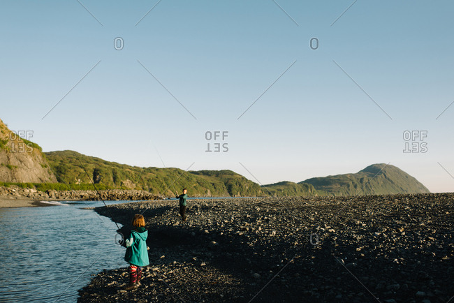 Two kids fishing on an Alaskan river