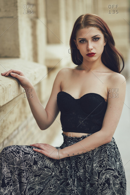 Young woman posing outdoors in urban background