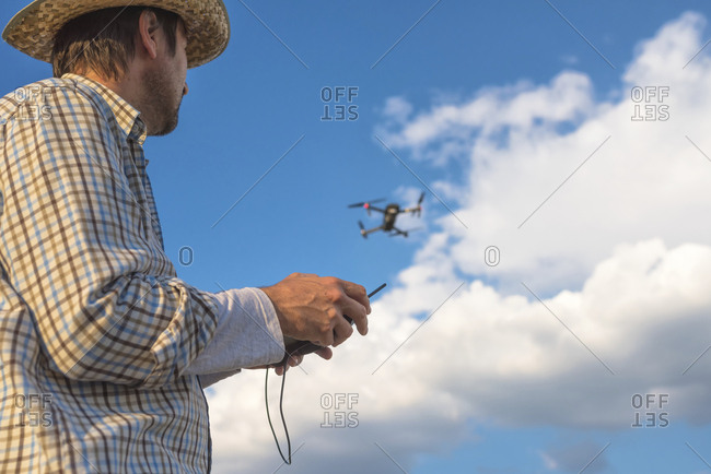 Farmer piloting drone