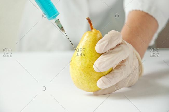GMO pear, conceptual image