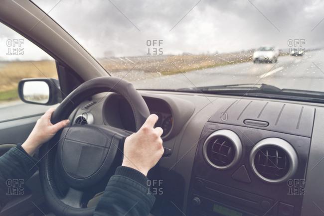 Woman driving a car, conceptual image