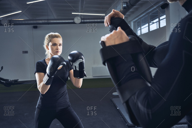 Woman practicing boxing at gym