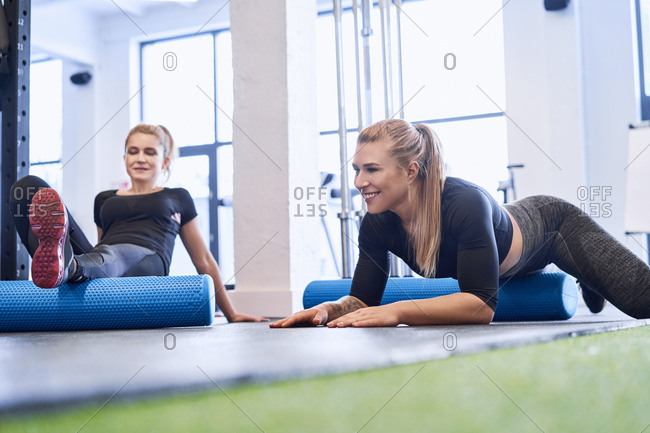 Two women massaging after gym workout
