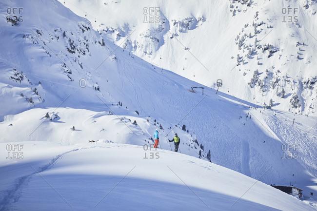 Austria- Tyrol- Kuehtai- two skiers in winter landscape