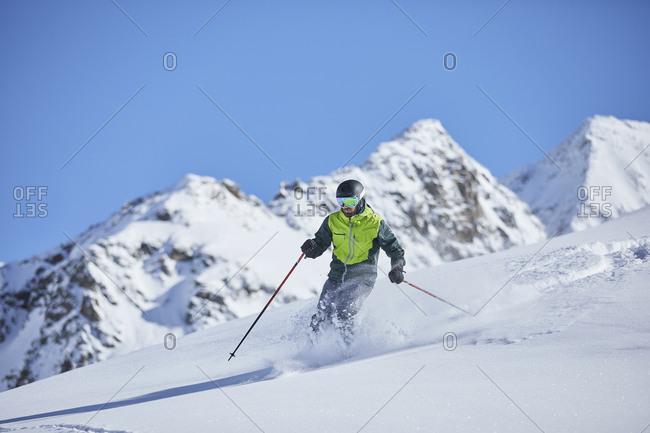 Austria- Tyrol- Kuehtai- man skiing in winter landscape