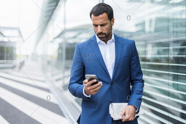 Portrait of businessman using smartphone