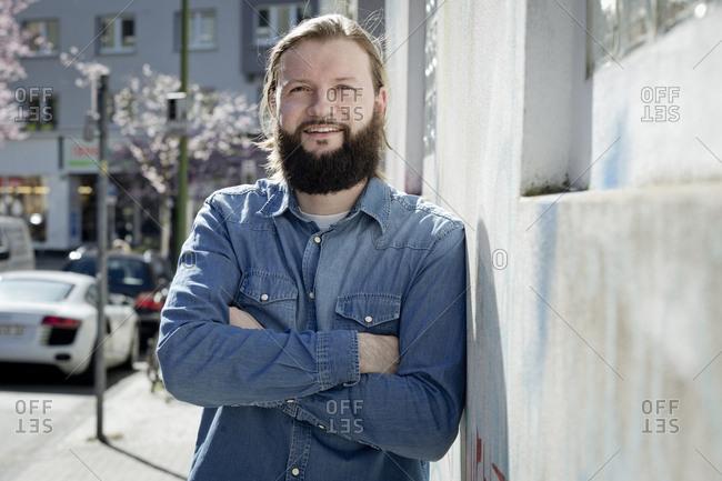 Portrait of bearded man wearing denim shirt