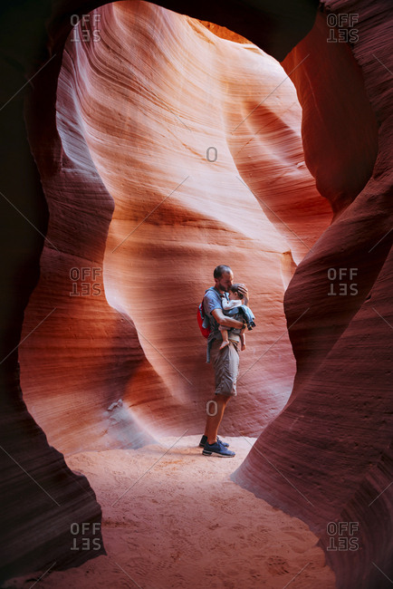 USA- Arizona- Father with baby on a baby carrier visiting Antelope Canyon