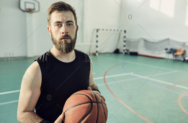Portrait of bearded man with basketball- indoor