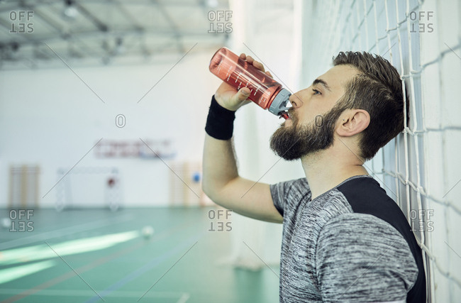 Basketball player drinking from plastic bottle