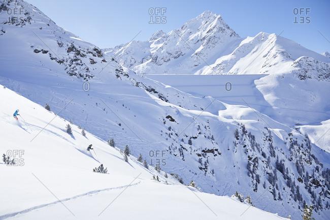 Austria- Tyrol- Kuehtai- couple skiing in winter landscape
