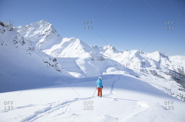 Austria- Tyrol- Kuehtai- female skier in winter landscape