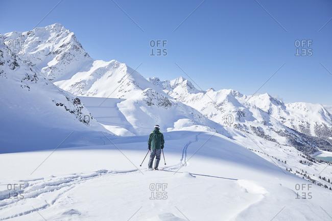 Austria- Tyrol- Kuehtai- skier in winter landscape