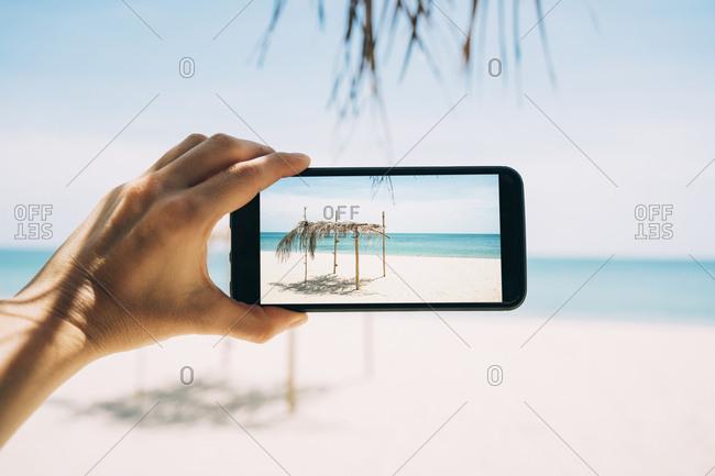 Thailand- Koh Lanta- Virgin Paradise Beach- woman taking photo with cell phone