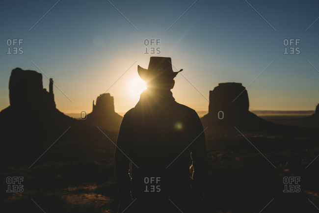 USA- Utah- Man with cowboy hat enjoying sunrise in Monument Valley