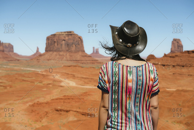 USA- Utah- Woman with cowboy hat enjoying the views in Monument Valley