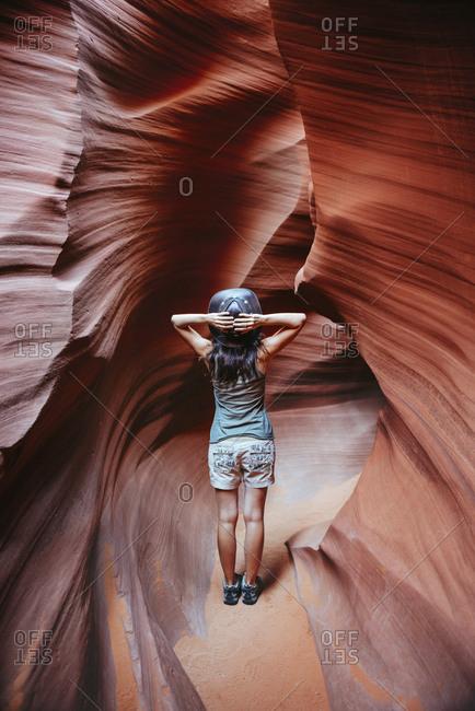 USA- Arizona- Woman with cowboy hat visiting Antelope Canyon