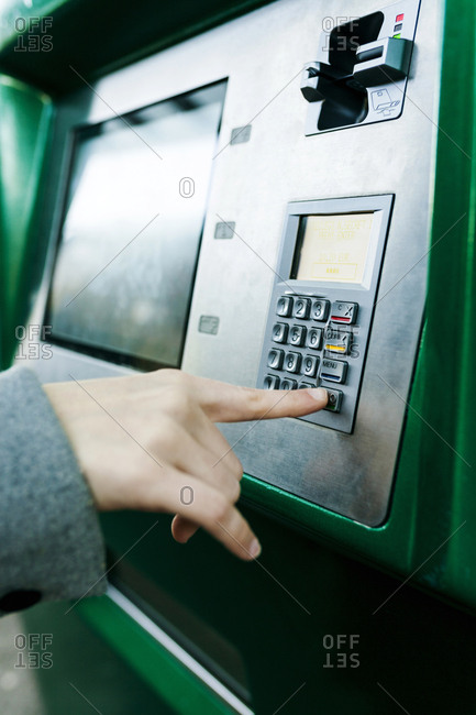 Spain- Barcelona- woman buying ticket from automated machine