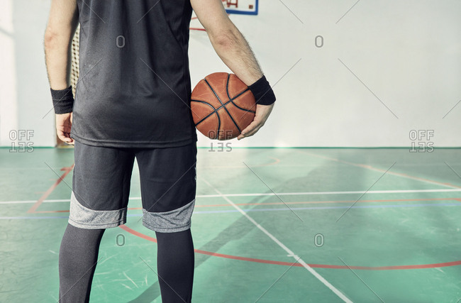 Man with basketball- indoor