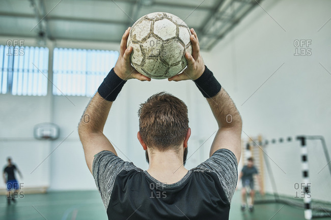 Close-up of indoor soccer player throwing in the ball