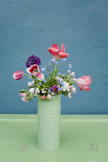 Vase with bouquet of flowers- leek blossom- forget-me-not- tulip