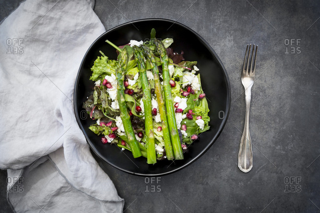 Mixed salad with fried green asparagus- feta and pomegranate seeds