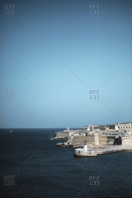 Lighthouse and historic fortification along coastline