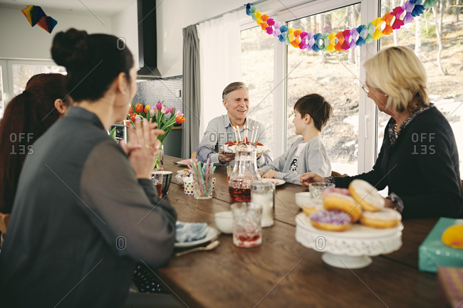 Family sitting at table during birthday party