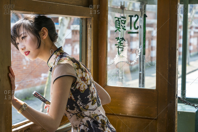 Shanghai, China - March 28, 2016: Young Chinese woman in old tram