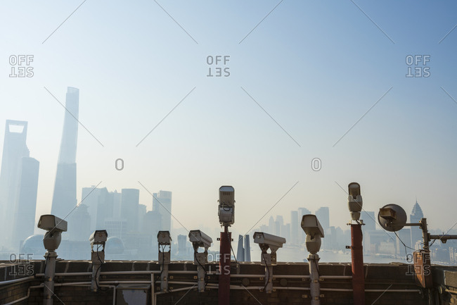 Shanghai, China - March 27, 2016: Security cameras lined up on rooftop