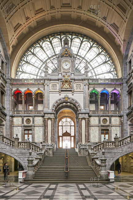 Antwerp, Belgium - June 13, 2018: Grand staircase in the main hall of Antwerpen-Centraal railway station of built in the eclectic style by architects Louis Delacenserie and Charles Poupaert