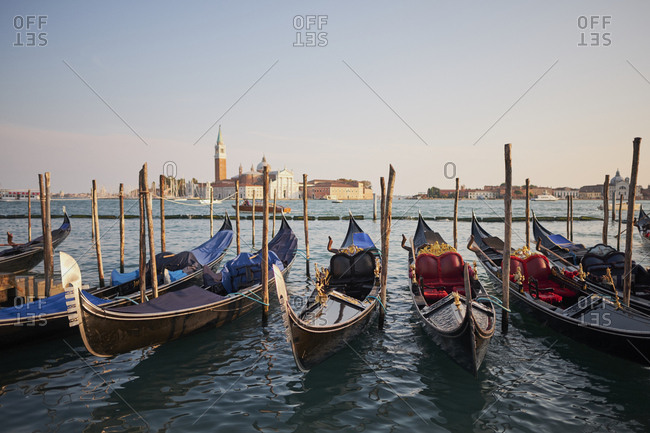 Venetian gondolas in the adriatic sea on the edge of San Marco, Venice, Italy