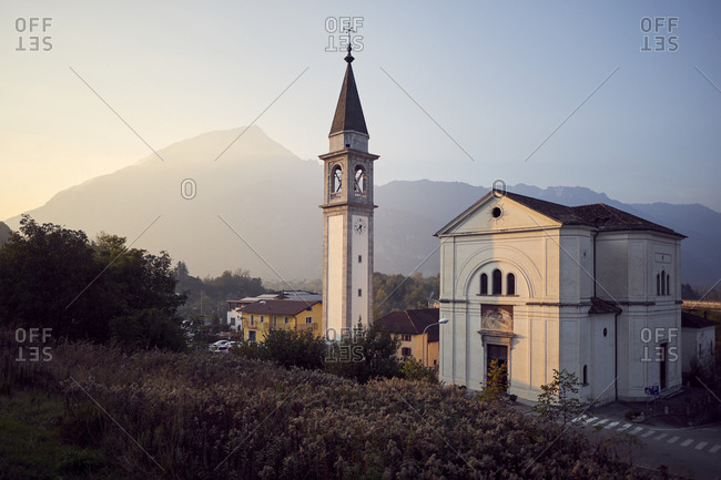 Church in northern italian village during sunset, Belluno, Italy