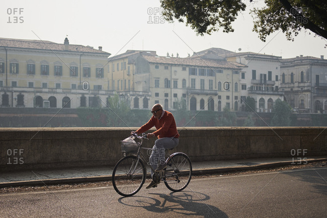 Venice, Italy - October 12, 2017: Older Italian man on bicycle