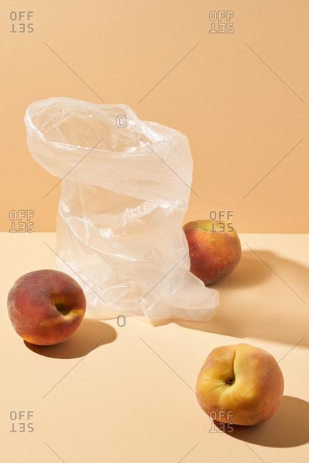 Studio shot of peaches and plastic bag