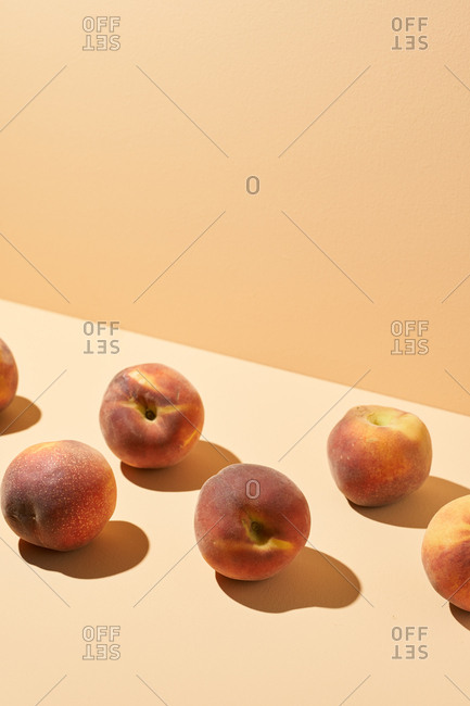 Ripe peaches photographed on peach background in studio