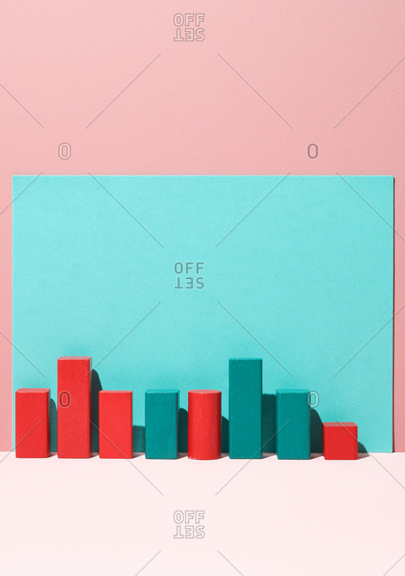 Wooden blocks lined up on colorful background in studio