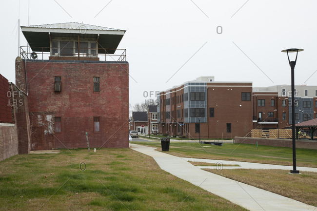Lorton, Virginia - December 12, 2017: Row of new town houses facing walls of former Lorton prison