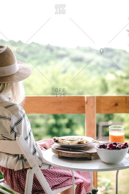 Woman eating breakfast outdoors