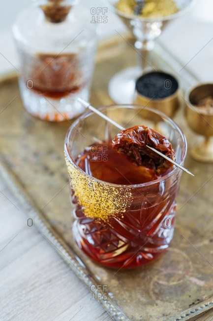 Mixed drink garnished with a dried tomato
